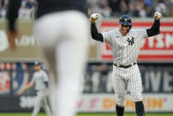 New York Yankees' Aaron Judge celebrates with teammates after hitting a winning RBI-single during the ninth inning of a baseball game against the Tampa Bay Rays, Sunday, Oct. 3, 2021, in New York. (AP Photo/Frank Franklin II)