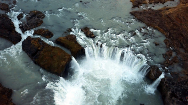<p>The drone footage captures footage from the black sand beaches of Reynisfjara to the gallons of water that cascade from the 'Waterfall of the Gods'. (Photo: Ran Rosenzweig/Caters News) </p>