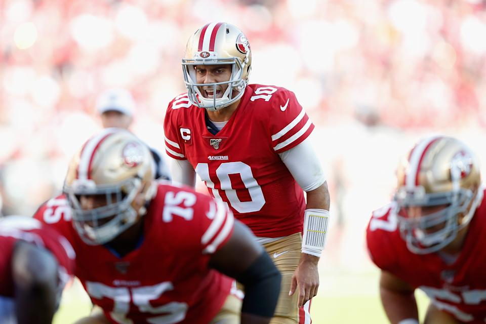 Quarterback Jimmy Garoppolo threw four touchdowns in the 49ers' win. (Photo by Lachlan Cunningham/Getty Images)