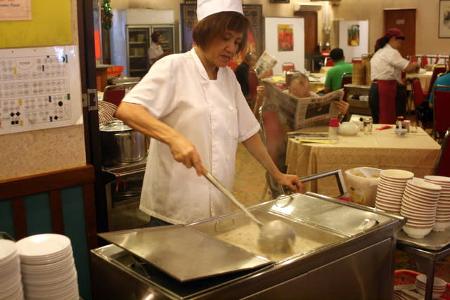 """Not all the carts are roving ones. This large congee """"cauldron"""" seems to stay put, while smaller carts ferry little bowls of congee to nearby tables."""