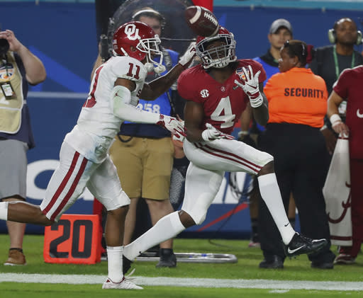 Alabama wide receiver Jerry Jeudy (4) eyes a pass as Oklahoma cornerback Parnell Motley (11) attempts to defend, during the second half of the Orange Bowl NCAA college football game, Saturday, Dec. 29, 2018, in Miami Gardens, Fla. (AP Photo/Wilfredo Lee)