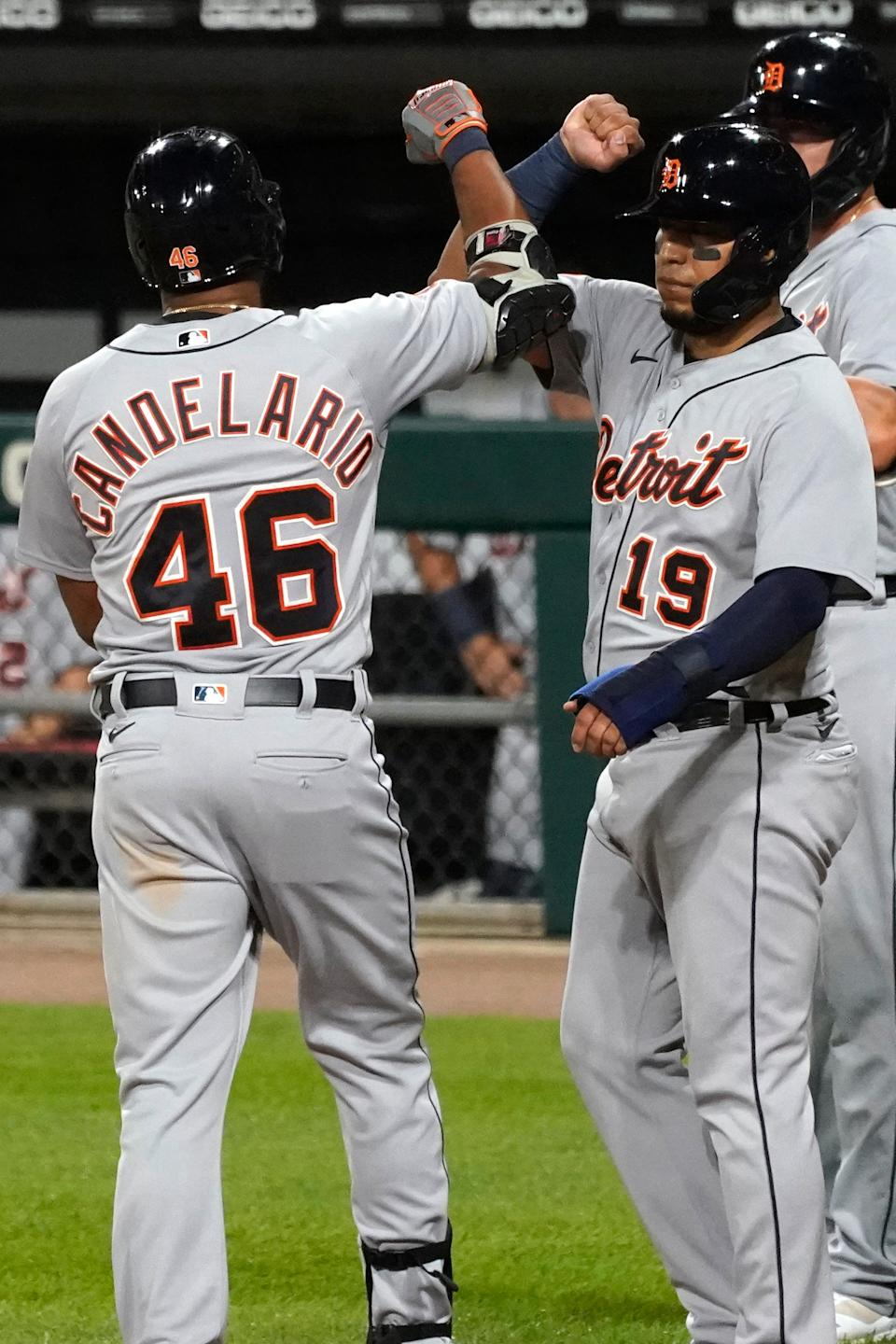 Tigers' Jeimer Candelario celebrates with Isaac Paredes, right, during a game in 2020.