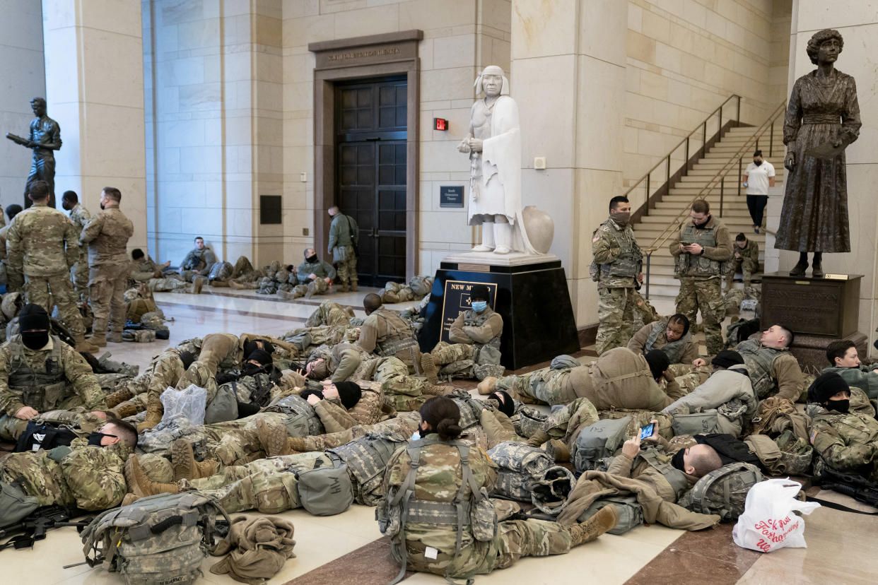 Members of the National Guard rest in the visitor's center of the Capitol