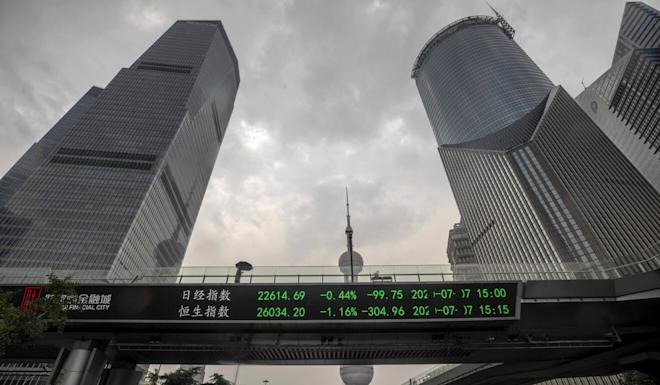Stock prices are displayed on an electronic board in Shanghai. Photo: EPA-EFE