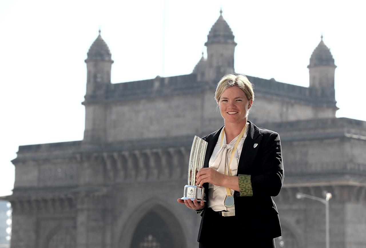 MUMBAI, INDIA - FEBRUARY 18:  Jess Cameron of Australia poses with the Player of the Match trophy in front of the iconic Gateway of India monument on February 18, 2013 in Mumbai, India. Australia won in the final between against the West Indies of the ICC Women's World Cup India 2013 played at the Cricket Club of India ground on February 17, 2013 in Mumbai, India. (Photo by Graham Crouch/ICC via Getty Images)