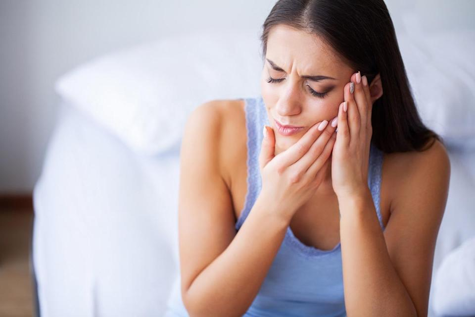 Woman Suffering From Painful Toothache