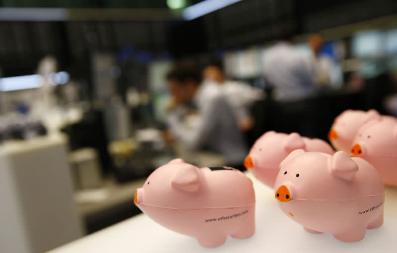 Toy pigs as lucky charms are seen at the stock exchange in Frankfurt