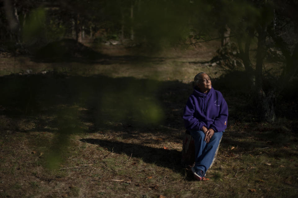 "Hazel Harding Currence, 78, a Herring Pond Wampanoag Tribe Elder, sits for a portrait in her backyard in Bourne, Mass., Tuesday, Oct. 6, 2020. ""We were exposed to disease. We were exposed to slavery. I mean, what happened here was people who came not just for religion, that might have been their purpose of leaving their homeland, but they came here and wanted to wipe out the existence of a whole culture,"" said Currence. ""We should have never been treated the way that we were, our ancestors,"" Currence added. ""I think that if they were here now, if they were looking down on us, I think they'd be very proud at the movement that's going forward now."" (AP Photo/David Goldman)"