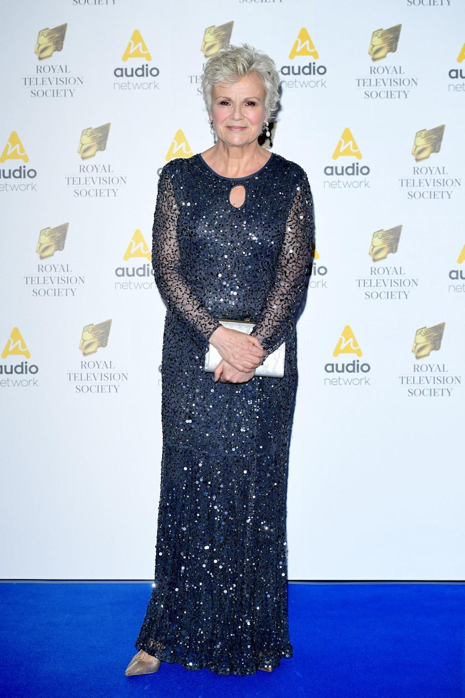 <p>Julie lit up the blue carpet in a shimmering navy gown that perfectly flattered her figure.<br><i>[Photo: PA]</i> </p>