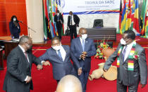 Southern African leaders greet each other during a meeting in Mozambique's capital Maputo, Thursday, April 8, 2021. Leaders met to discuss ways to respond to the violence by Islamic extremist rebels in the country's northern Cabo Delgado province where thousands of people have been killed and displaced. (AP Photo/Ferhat Momade)