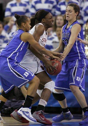 CORRECTS TO REGIONAL FINAL, INSTEAD OF SEMIFINAL - Stanford's Nnemkadi Ogwumike is trapped by Duke's Shay Selby and Haley Peters in the first half of an NCAA women's tournament regional final college basketball game Monday, March 26, 2012, in Fresno, Calif. (AP Photo/Gary Kazanjian)