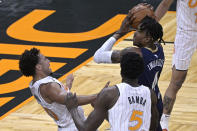 New Orleans Pelicans forward Wes Iwundu (4) is fouled by Orlando Magic guard Devin Cannady, left, while driving to the basket during the second half of an NBA basketball game Thursday, April 22, 2021, in Orlando, Fla. (AP Photo/Phelan M. Ebenhack)