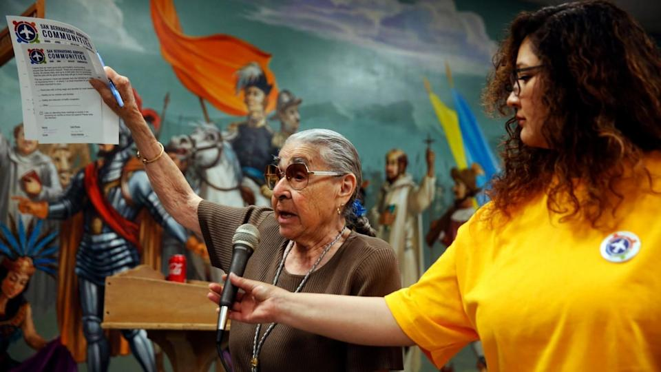 Margaret Cisneros speaks at a town hall meeting at Our Lady of Hope Church in San Bernardino in 2019.