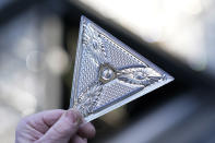 A worker holds one of the 192 Waterford crystal triangles that will be placed on the Times Square New Year's Eve ball, Sunday, Dec. 27, 2020, in New York. (AP Photo/Kathy Willens)