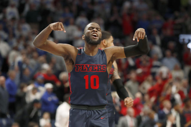Dayton's Jalen Crutcher celebrates after hitting a shot with less than a second left to defeat Saint Louis 78-76 in overtime in an NCAA college basketball game Friday, Jan. 17, 2020, in St. Louis. (AP Photo/Jeff Roberson)