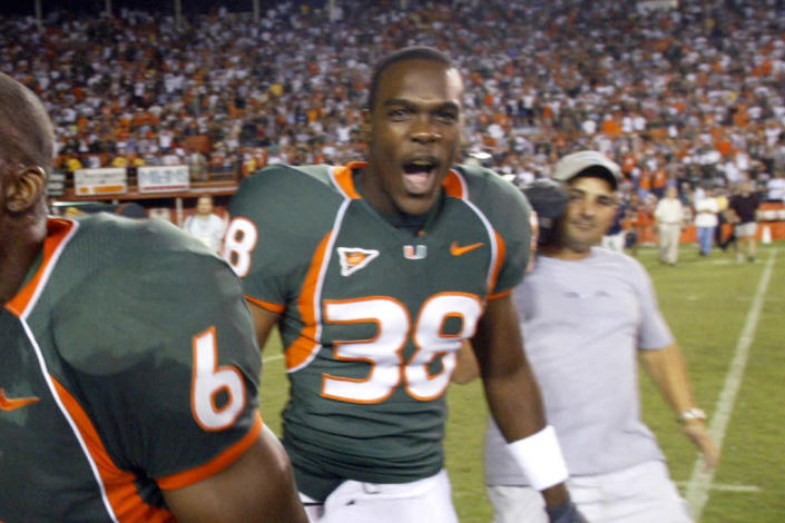 FILE - In this Nov. 14, 2004, file photo, Miami's Rashaun Jones, center, celebrate after the team's 41-38 win over Louisville in an NCAA college football game at the Orange Bowl in Miami. The former University of Miami football player was arrested Thursday, Aug. 19, 2021, in connection with the 2006 fatal shooting of his teammate Bryan Pata. Pata, a 22-year-old, 6-foot-4, 280-pound defensive lineman, was shot several times outside of his Kendall, Fla., apartment the night of Nov. 7, 2006. ((Jared Lazarus/Miami Herald via AP, File)