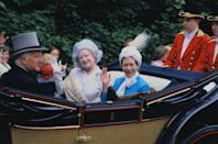 <p>Princess Margaret and the Queen Mother waving to the crowds from their carriage at the Royal Ascot. </p>