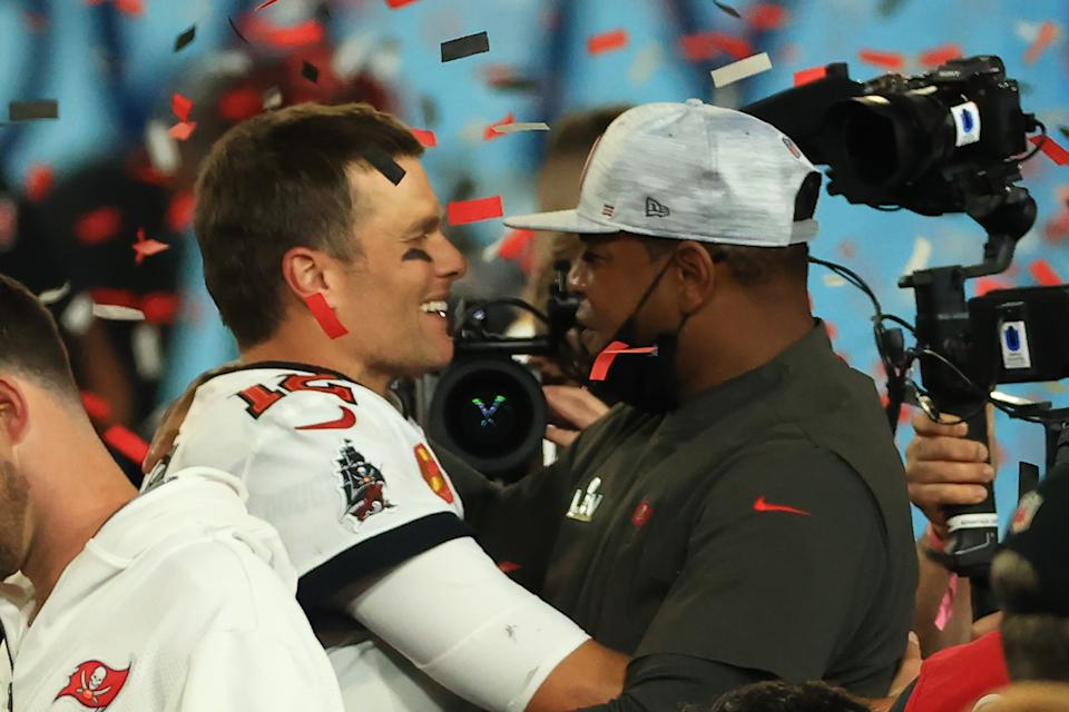 Tom Brady of the Tampa Bay Buccaneers celebrates with offensive coordinator Byron Leftwich after defeating the Kansas City Chiefs in Super Bowl LV. (Photo by Mike Ehrmann/Getty Images)