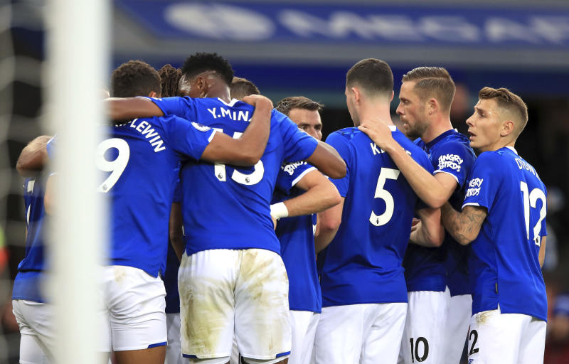 Everton's Dominic Calvert-Lewin, left, celebrates with teammates after scoring the first goal against Manchester City, during their English Premier League soccer match at Goodison Park in Liverpool, England, Saturday Sept. 28, 2019. (Peter Byrne/PA via AP)