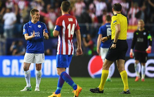 <span>Marc Albrighton (left) disputes the decision of referee Jonas Eriksson to award Atlético a first-half penalty following his challenge on Antoine Griezmann</span> <span>Credit: Getty Images  </span>