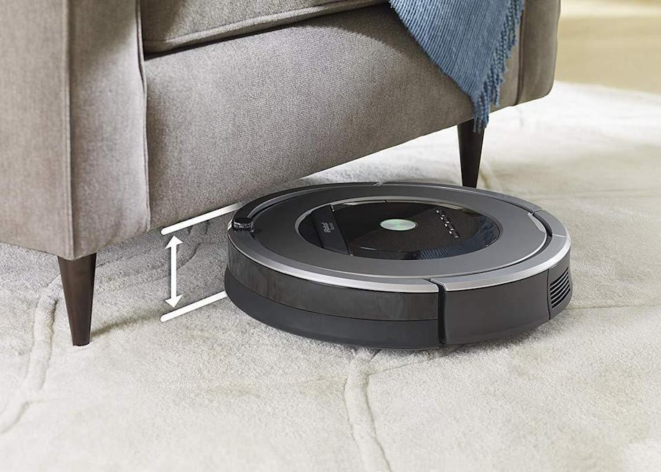 The Roomba is just 3.6 inches tall, so it fits under most furniture. (Photo: Amazon)