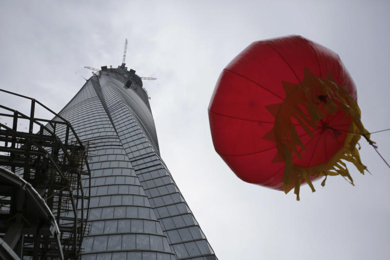 The Shanghai Tower is seen prior to the topping off ceremony in Shanghai, China, Saturday, Aug. 3, 2013. The Shanghai Tower is set to become the tallest building in China which is planned to be complete in 2014. (AP Photo/Eugene Hoshiko)