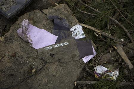 Property zoning paperwork lies in a debris field left by a mudslide in Oso, Washington, April 3, 2014. REUTERS/Max Whittaker