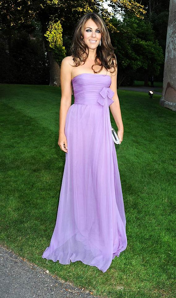 "The stylish soiree was also visited by the uber elegant Elizabeth Hurley, who took our breath away in an ethereal lavender looker, tousled coif, and diamond hoop earrings. Dave M. Benett/<a href=""http://www.gettyimages.com/"" target=""new"">GettyImages.com</a> - July 7, 2010"