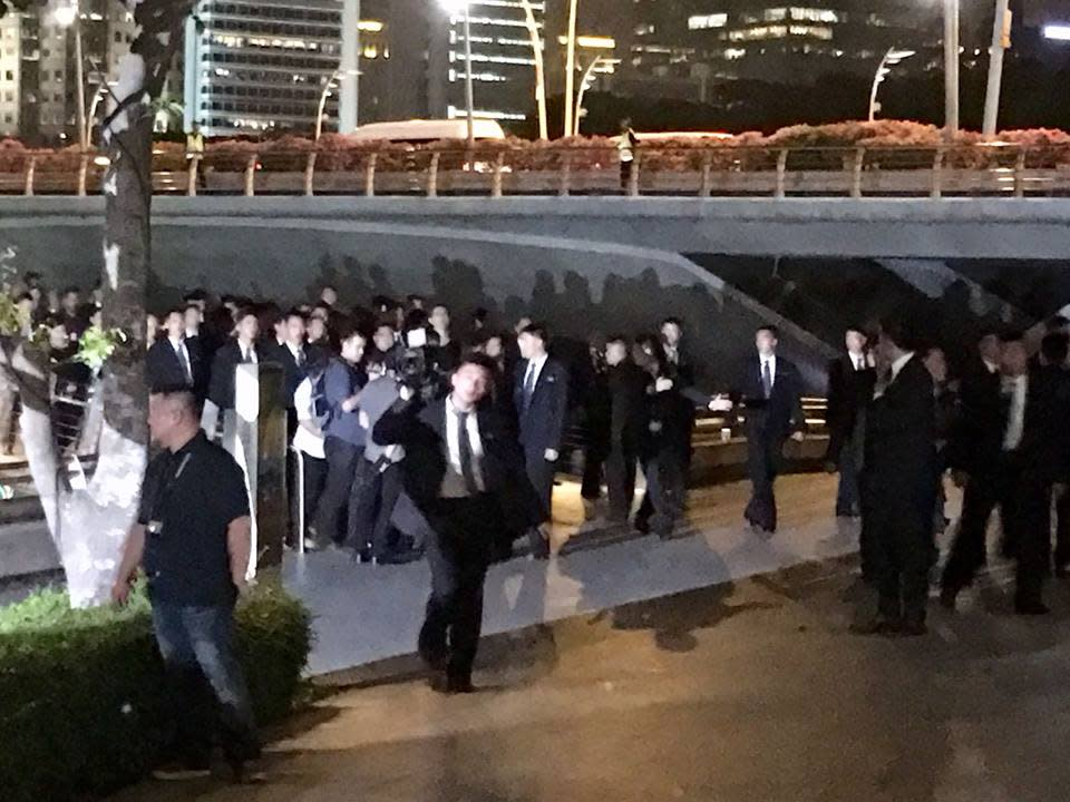 <p>Kim Jong Un and his entourage seen in the Esplanade area on 11 June 2018. (PHOTO:Vernon Lee/Yahoo News Singapore) </p>