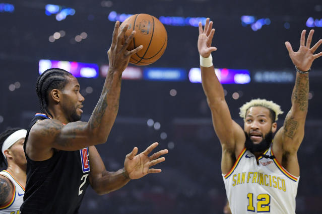 Los Angeles Clippers forward Kawhi Leonard, left, passes the ball as Golden State Warriors guard Ky Bowman defends during the first half of an NBA basketball game Friday, Jan. 10, 2020, in Los Angeles. (AP Photo/Mark J. Terrill)