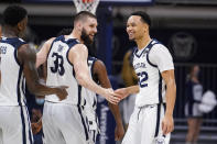 Butler guard Jair Bolden (52) celebrates after a three-point basket with forward Bryce Golden (33) in the second half of an NCAA college basketball game against Villanova in Indianapolis, Sunday, Feb. 28, 2021. (AP Photo/Michael Conroy)