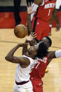 Cleveland Cavaliers guard Collin Sexton (2) bobbles the ball in front of Houston Rockets guard Victor Oladipo (7) during the first half of an NBA basketball game Monday, March 1, 2021, in Houston. (AP Photo/Michael Wyke)