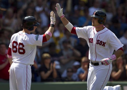 Boston Red Sox's Will Middlebrooks, right, is welcomed to home plate by teammate Daniel Nava, left, after hitting a home run off a pitch by Cleveland Indians Justin Masterson in the third inning of a baseball game at Fenway Park in Boston, Sunday, May 13, 2012. (AP Photo/Steven Senne)