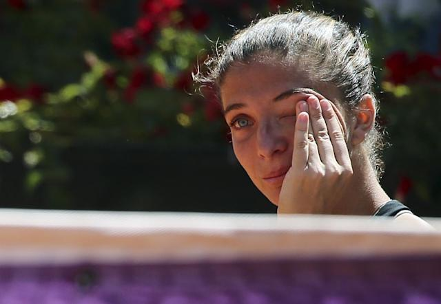 Italy's Sara Errani, wipes her tears at the end the final match against Serena Williams at the Italian open tennis tournament in Rome, Sunday, May 18, 2014. Serena Williams kept the crowd from being a factor in a 6-3, 6-0 victory over 10th-seeded Sara Errani to win the Italian Open for the third time Sunday. (AP Photo/Gregorio Borgia)