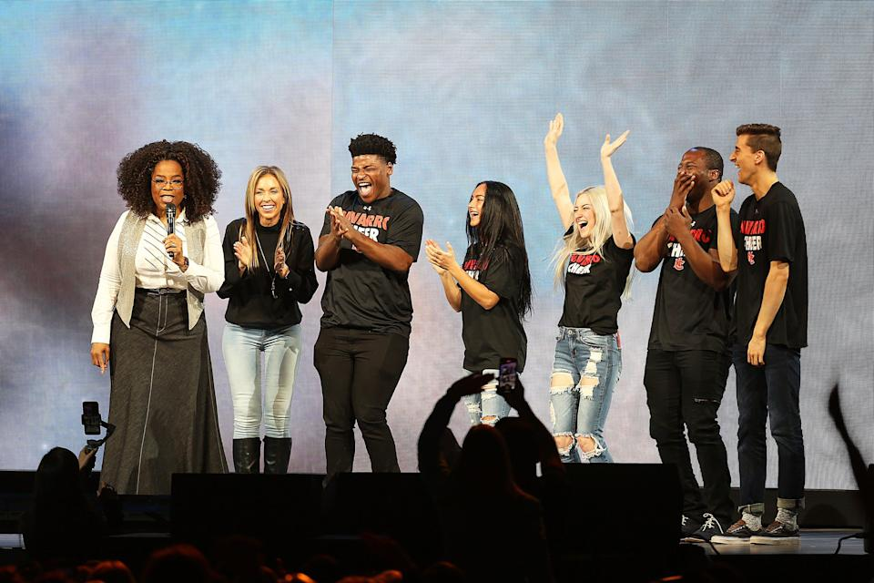 """Oprah Winfrey speaks with the cast of Netflix's """"Cheer"""", (L-R) Monica Aldama, Jerry Harris, Gabi Butler, Lexi Brumback, TT Barker and Dillon Brandt during Oprah's 2020 Vision: Your Life in Focus Tour presented by WW (Weight Watchers Reimagined) at American Airlines Center on February 15, 2020 in Dallas, Texas."""