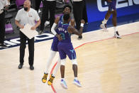 Charlotte Hornets forward Jalen McDaniels, back, reacts with guard Terry Rozier (3) after he made a three-point basket during the second half of an NBA basketball game against the Washington Wizards, Sunday, May 16, 2021, in Washington. (AP Photo/Nick Wass)