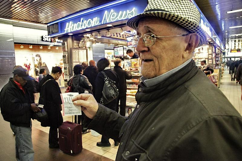 Alfredo Mora, 91, shows off his lottery ticket for a chance at the historic Mega Millions jackpot, that reached more than $600 million on Friday, March 30, 2012, in New York.  After nobody won the March 27 drawing, the jackpot rolled over creating the largest pool of lottery money ever recorded in the world, according to the Mega Millions website. The previous record was $390 million. (AP Photo/Bebeto Matthews)