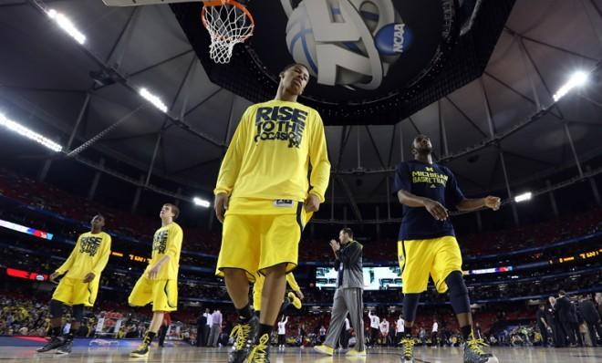 The Michigan Wolverines warm up for their NCAA championship game against the Louisville Cardinals.