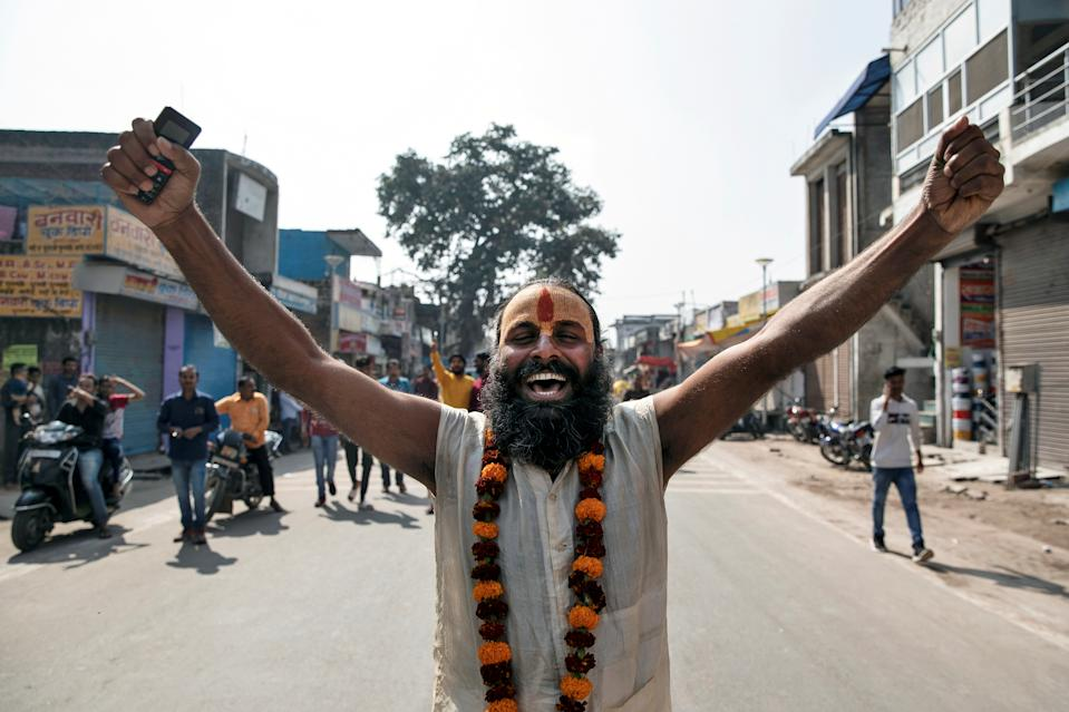 A Sadhu or a Hindu holy man celebrates after Supreme Court's verdict on a disputed religious site, in Ayodhya, India, November 9, 2019. REUTERS/Danish Siddiqui