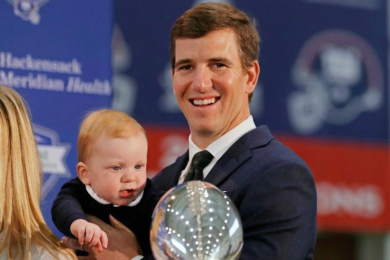 Eli Manning and son Charlie | Adam Hunger/AP/Shutterstock