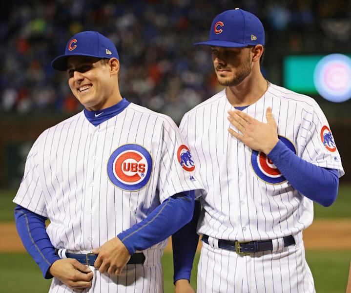 Anthony Rizzo (L) and Kris Bryant of the Chicago Cubs, seen during player introductions ahead of their home opening game against the Los Angeles Dodgers, at Wrigley Field in Chicago, Illinois, on April 10, 2017