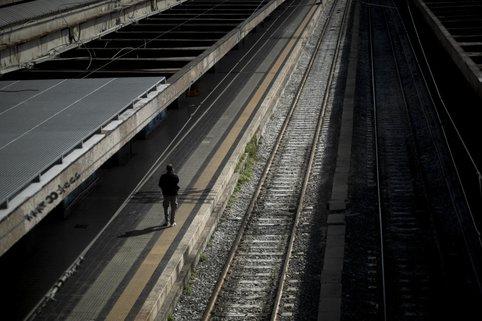 A passenger waits at the Termini Central Station during the Coronavirus emergency, on March 9, 2020 in Rome, Italy. Italian Prime Minister Giuseppe Conte announced the closure of the Italian region of Lombardy in an attempt to stop the ongoing coronavirus epidemic in the Italian country. The number of confirmed cases of the Coronavirus COVID-19 disease in Italy has jumped up to at least 6387, while the death toll has surpassed 366. (Photo by Antonio Masiello/Getty Images)