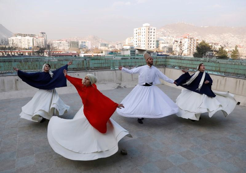 Mirzaie, founder of a Sama Dance group dances with her teammates in Kabul
