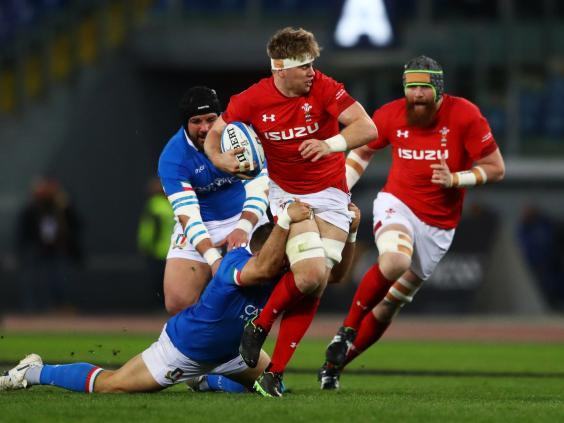 Aaron Wainwright is tackled during Wales' Six Nations clash with Italy (Getty)