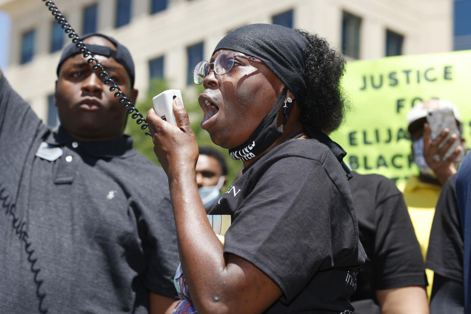 FILE - In this June 27, 2020, file photo, Sheneen McClain speaks during a rally and march over the death of her 23-year-old son Elijah McClain, outside the police department in Aurora, Colo. A drug called ketamine that's injected as a sedative during arrests has drawn new scrutiny since a young Black man named Elijah McClain died in suburban Denver. An analysis by The Associated Press of policies on ketamine and cases where it was used nationwide uncovered a lack of police training, conflicting medical standards and nonexistent protocols that have resulted in hospitalizations and even deaths. (AP Photo/David Zalubowski, File)