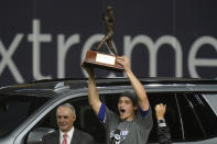Los Angeles Dodgers shortstop Corey Seager holds up the MVP trophy after defeating the Tampa Bay Rays 3-1 to win the baseball World Series in Game 6 Tuesday, Oct. 27, 2020, in Arlington, Texas. (AP Photo/Eric Gay)