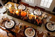 """<p>If you're worried about overdoing your Thanksgiving table decor, use a long box to help keep it contained. Here, blogger Anita Diaz filled her pallet wood box with floral foam, and then placed pumpkins, berries, candles, and cedar on top. </p><p><strong>Get the tutorial at <a href=""""http://anita-faraboverubies.blogspot.com/2013/03/17-ways-to-use-long-box-as-centerpiece.html"""" rel=""""nofollow noopener"""" target=""""_blank"""" data-ylk=""""slk:Far Above Rubies"""" class=""""link rapid-noclick-resp"""">Far Above Rubies</a>.</strong></p><p><strong><strong><a class=""""link rapid-noclick-resp"""" href=""""https://www.amazon.com/slp/gourd-decorations/5ct8qwd5uto49bg?tag=syn-yahoo-20&ascsubtag=%5Bartid%7C10050.g.2130%5Bsrc%7Cyahoo-us"""" rel=""""nofollow noopener"""" target=""""_blank"""" data-ylk=""""slk:SHOP DECORATIVE GOURDS"""">SHOP DECORATIVE GOURDS</a></strong><br></strong></p>"""