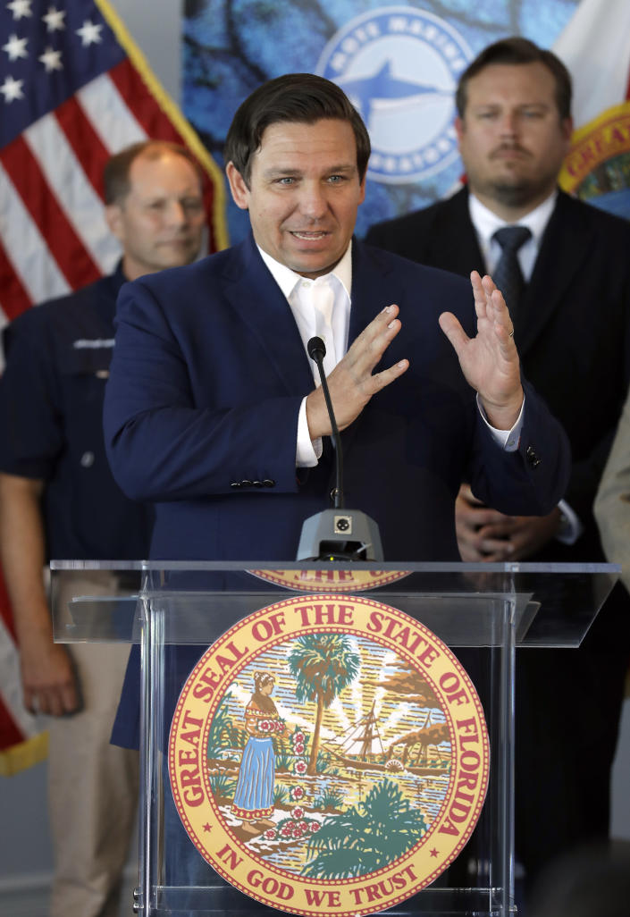 Florida Gov. Ron DeSantis speaks after signing a red tide mitigation and technology development initiative into law during a news conference at Mote Marine Laboratory Thursday, June 20, 2019, in Sarasota, Fla. DeSantis says Florida will commit $3 million a year for the next five years for the purpose of prioritizing red tide prevention. (AP Photo/Chris O'Meara)
