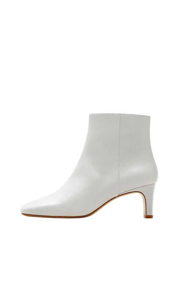 "<p><strong>Mango</strong></p><p>mango.com</p><p><strong>$119.99</strong></p><p><a href=""https://shop.mango.com/us/women/shoes-boots-and-booties/heel-leather-ankle-boot_43040606.html"" target=""_blank"">SHOP IT</a></p><p>No colored boot is more versatile for summer than white. It's a blank canvas for you to wear with floral dresses, denim midi skirts, and lightly-washed distressed jeans. This kitten heel gives you a little elevation without the foot pain and the smooth design makes it look way more expensive than its $120 price tag.<br></p>"