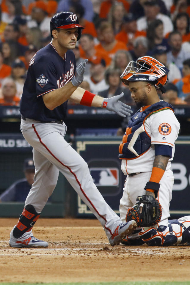Washington Nationals' Ryan Zimmerman celebrates past Houston Astros catcher Martin Maldonado after his home during the second inning of Game 1 of the baseball World Series Tuesday, Oct. 22, 2019, in Houston. (AP Photo/Matt Slocum)